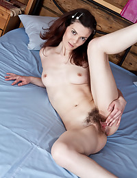 Leggy Teen Spreads Her Bushy Muff