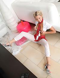 Blue-eyed blonde Pinky June rides a dildo pillow