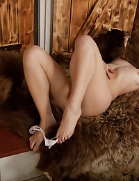 Sitting on her soft furry rug, Dosya strips down to her bare sexy body and rubs her own fur!