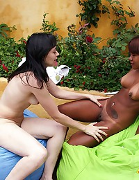 Interracial girl on girl fisting action in the back yard