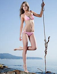 Luba is looking hot as hell in her pink string bikini today.
