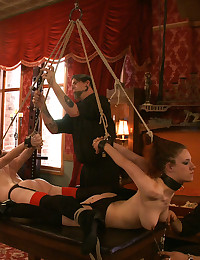 House slaves grace and katt are put through a workout to wear out their arms and are then placed in cruel strappado bondage and punished.