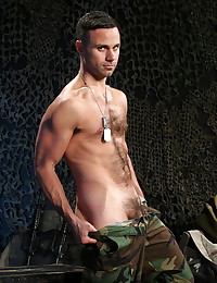 Hairy military man strips