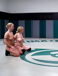 Four girls wrestle in gallery