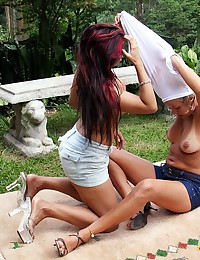 Two amateur girls fisting one another in the back yard
