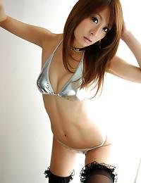 Sexy babe in shiny bikini