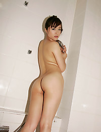 Luscious Asian Minx Exposes Pussy