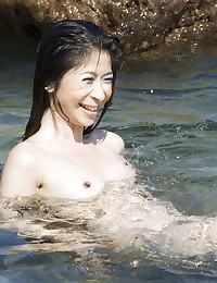Asian Beauty Strips At The Beach