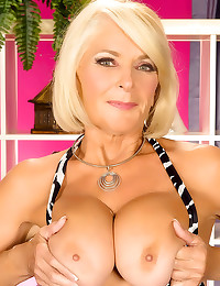 Mature does hot striptease