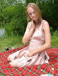 Diana has a naughty picnic in this Nude Dolls gallery.