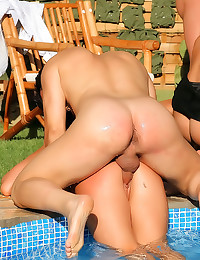 Hot sluts in poolside orgy