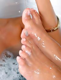 Lesbian foot play in bath