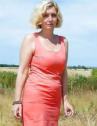 Girl in a field is curvy