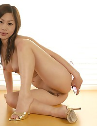 Glass toy in Asian pussy