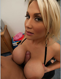 Thick cock between her tits