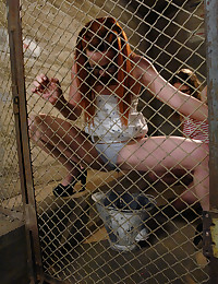 Locked in a cage and made to piss in a bucket