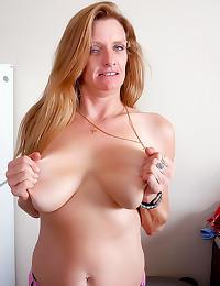 Blue eyed big tits mature