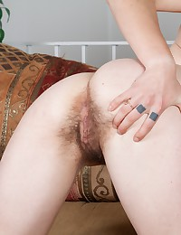 A moment many would wait for, Usnea spreads her pale thighs and reveals her sexy hairy pussy to you all. Her bush gets nice and wet as she gently spreads her lips.