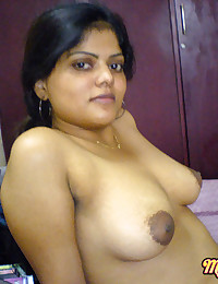 Delicious Neha stripping her pink saree off showing pussy