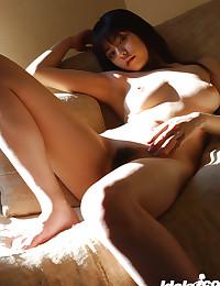 Slender Japanese girl with ho...