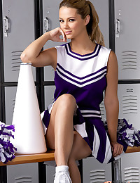 The busty girl is a cheerleader getting naked in the locker room