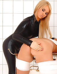 Leather catsuit girl spanks submissive