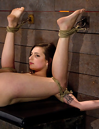 Super cute girl next door gets severely bound, suffers the cane, made to squirt, and fucked like a whore by Isis Love and her huge strap-on.