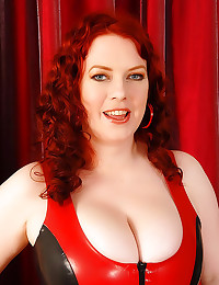 Femdom redhead in latex dress