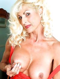 Big boobs on blonde mature