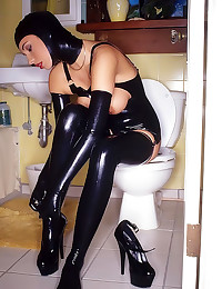 Kinky chick showers in latex