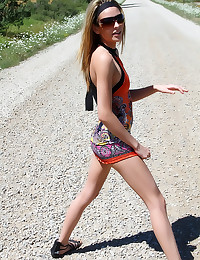 Skinny chick in slut dress outdoors