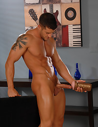 Muscular guy uses sex toy