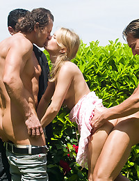 Three guys bang her outdoors