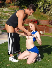 Cheerleader redhead fucks outdoors