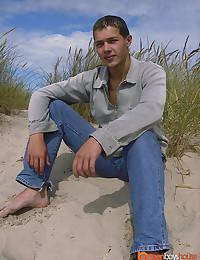 Skinny boy at beach