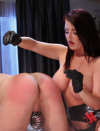 Sophie Dee catches her husband masturbating then punishes him with CBT, spanking, eating his cum from her toes, chastity and a hard strap-on fucking.