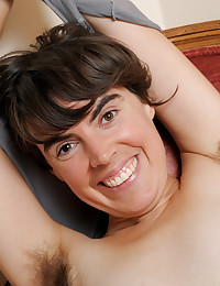 The smiling chick with the hairy pussy and the hairy armpits is doing her best to arouse.