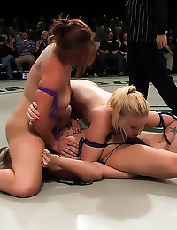 Women in bikinis wrestle lust...