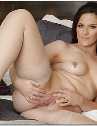 A pierced nipple chick in stockings