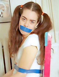 Pigtailed teen bound by tape