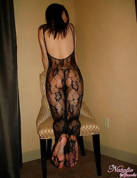 She wears a stunning sheer bl...