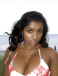 Dark-skinned hottie posing naked