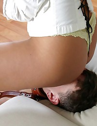 Goddess gags slaves mouth with her pants and sits on his face