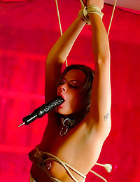 Tight corset on bondage girl