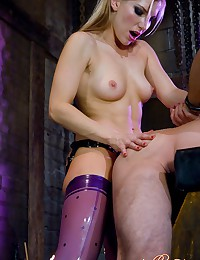 Wicked hot dominatrix in rubb...
