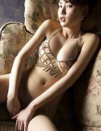 Curvy Asian Minx Teases Us All