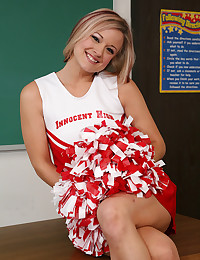 Cheerleader shows her pussy