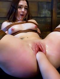 Bound girl takes fist in wet ...