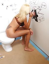 Blonde sucks an anonymous stiffy trough wall