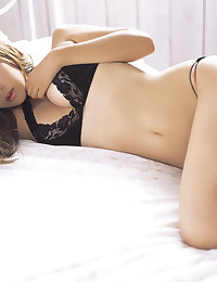 Sultry Asian Minx Wearing Lingerie